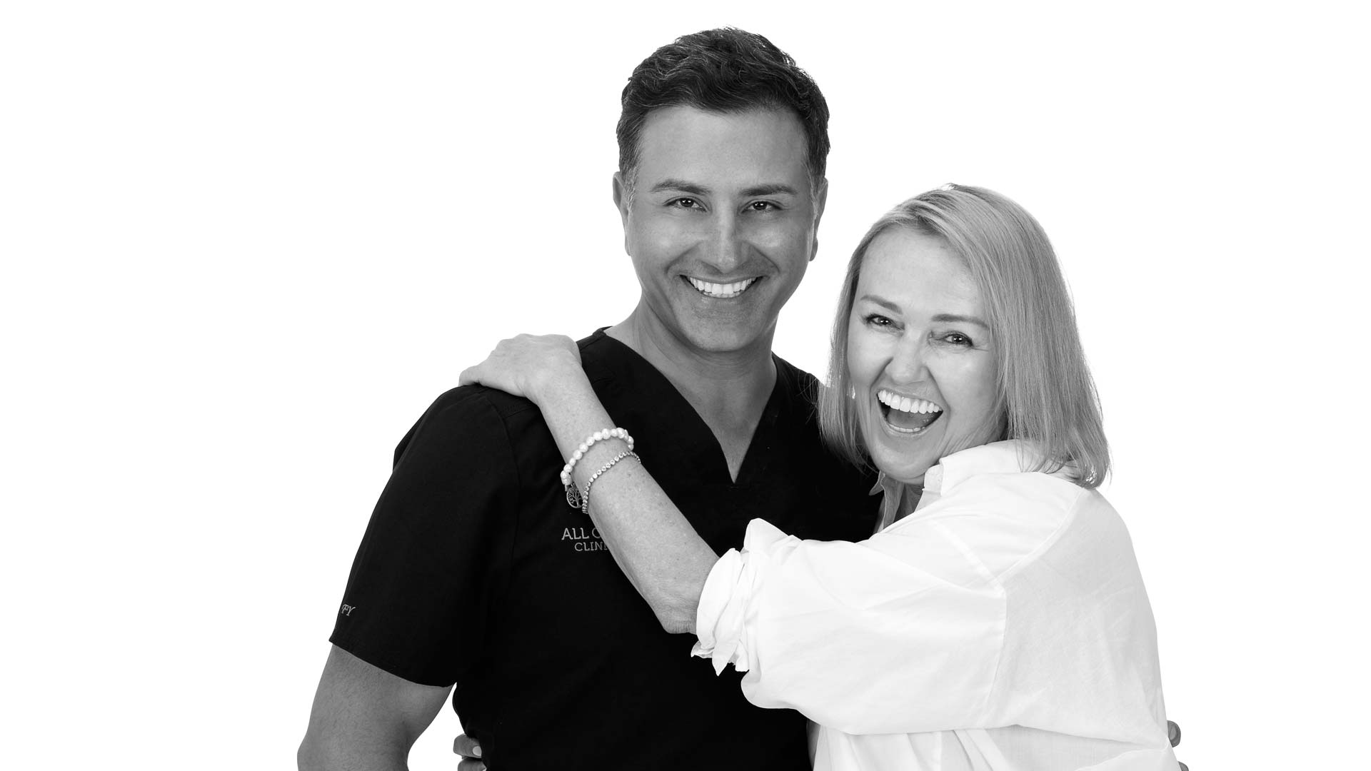 All on 4 dental implant dentist Dr Fadi Yassmin smiling next to a patient.