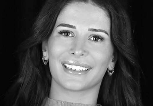 A patient smiling to show her natural-looking smile created by Dr Fadi Yassmin using Digital Smile Design.